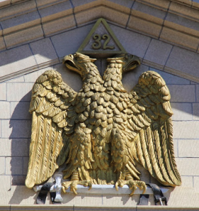 Double-headed eagle at apex of Scottish Rite Masonic Center