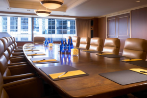 A board room with table and chairs