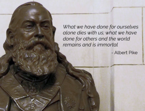 Bronze bust of Albert Pike with quote that reads What we have done for ourselves dies with us, what we have done for others and the world remains and is immortal